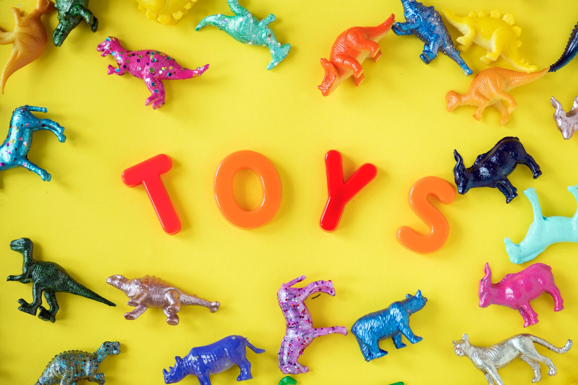 alphabet letters and toy dinosaurs